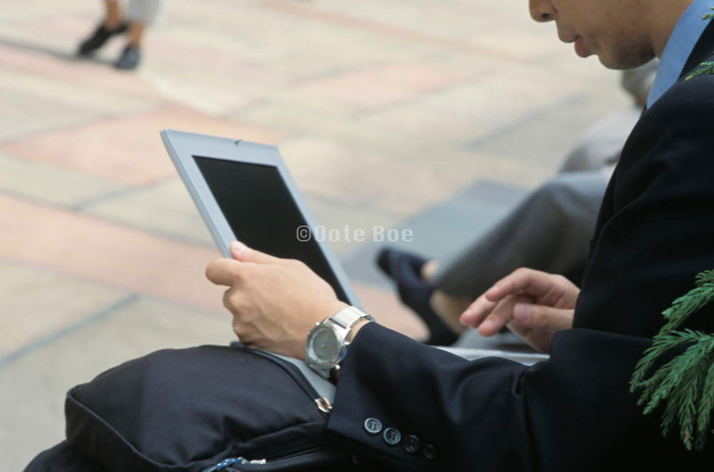 seated businessman working on his laptop
