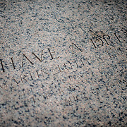 A small plaque etched into marble on the steps of the Lincoln Memorial marks the spot where Dr. Martin Luther King delivered his famous address on August 28, 1963.