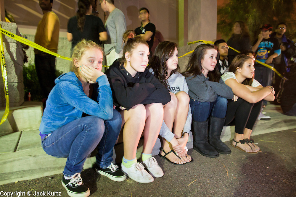 """24 NOVEMBER 2011 - PHOENIX, AZ: L to R: Brit Reid (CQ) 15, Sydney Salazar (CQ) 15, Citlaly Morris (CQ), 17, Nicole Nardecchia (CQ), 16 and Alex Benton, (CQ), 16, all from Phoenix, watch the Harry Potter movie in the parking lot at the Best Buy store on Thunderbird and I 17 in Phoenix. """"Black Friday,"""" the unofficial start of the holiday shopping season started even earlier than normal. Many stores, including Target and Best Buy, opened at midnight. The Best Buy at Thunderbird and I 17 showed a Harry Potter movie on the side of a rented truck in the parking lot to keep people amused while they waited for the store to open.   Photo by Jack Kurtz"""