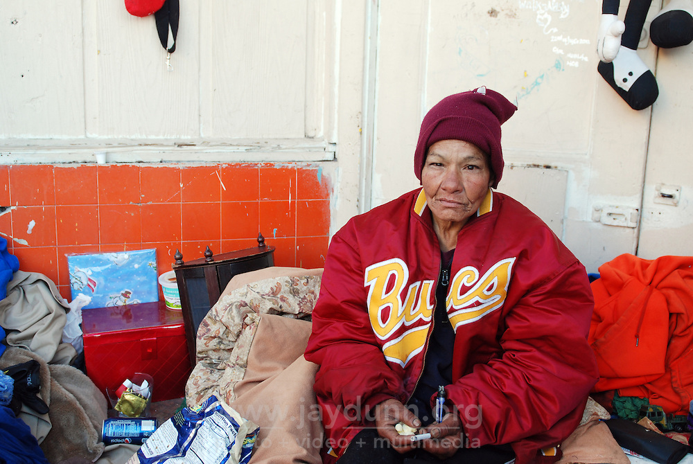 """""""Shorty,"""" in the doorway she has occupied in front of the Victory Mission on Soledad Street. On Thursday, Salinas city workers, health officials and police conducted an early morning sweep of the Chinatown homeless population, removing all encampments on the street."""