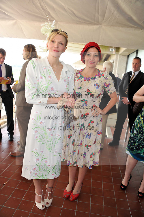 Left to right, COURTNEY LOVE and PEARL LOWE at the 3rd day of the 2011 Glorious Goodwood Racing Festival - Ladies Day at Goodwood Racecourse, West Sussex on 28th July 2011.