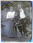 parents posing with their young son France early 1900s