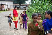 Tabasum Khatun, 14, is walking with other children on a road of Algunda village, pop. 1000, Giridih District, rural Jharkhand, India.