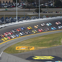 Jimmie Johnson (48) leads the pack out of turn four during the 58th Annual NASCAR Daytona 500 auto race at Daytona International Speedway on Sunday, February 21, 2016 in Daytona Beach, Florida.  (Alex Menendez via AP)