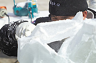 "Wurtsboro, New York - Ice carver Chris Uyehara works on his sculpture during a contest at the Winterfest on Feb. 8, 2014. Uyehara on the People's Choice Award and first place for his sculpture ""Ice Cupid"".The festival is sponsored and organized by the Wurtsboro Board of Trade."