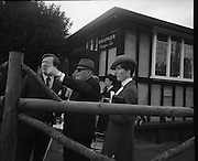 The Bollinger Bar at Phoenix Park..1972..07.10.1972..10.07.1972..7th October 1972..As part of the Phoenix Park races Bollinger opened a bar to facilitate the Champagne tastes of the racegoers...Image of Mr Tom McCairns, racehorse owner,pointing out the way to the winners enclosure (hopefully) to Mr and Mrs Tom Whelehan