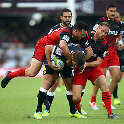DURBAN, SOUTH AFRICA - MARCH 26:  Ryan Crotty of the BNZ Crusaders and Andy Ellis of the BNZ Crusaders tackle Willie le Roux of the Cell C Sharks during the Super Rugby match between Cell C Sharks and BNZ Crusaders at Growthpoint Kings Park on March 26, 2016 in Durban, South Africa. (Photo by Steve Haag)<br /> <br /> images for social media must have consent from Steve Haag
