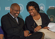 Houston ISD Trustee Paula Harris, right, talks with Prairie View A&M president Dr. George C. Wright, left, during a media conference announcing a partnership between Jones Futures Academy and the Prairie View A&M Nursing School, April 15, 2015.