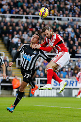 Steven Taylor of Newcastle United heads clear from Steven Fletcher of Sunderland going on to cut his head in the resulting collision - Photo mandatory by-line: Rogan Thomson/JMP - 07966 386802 - 21/12/2014 - SPORT - FOOTBALL - Newcastle upon Tyne, England - St James' Park - Newcastle United v Sunderland - Tyne-Wear derby - Barclays Premier League.