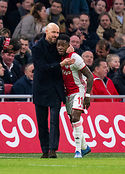 Quincy Promes #11 of Ajax and Coach Erik ten Hag of Ajax celebrate the first goal for Ajax during the match between Ajax and PSV at Johan Cruyff Arena on February 02, 2020 in Amsterdam, Netherlands