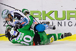 Martin Grabher Meier (EHC Liwest Linz, #91) vs Brock McBride (HDD Tilia Olimpija, #10) during ice-hockey match between HDD Tilia Olimpija and EHC Liwest Black Wings Linz at fourth match in Semifinal  of EBEL league, on March 13, 2012 at Hala Tivoli, Ljubljana, Slovenia. (Photo By Matic Klansek Velej / Sportida)