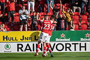 Jake Hastie of Rotherham United and Carlton Morris of Rotherham United celebrate the fifth goal for Rotherham during the EFL Sky Bet League 1 match between Rotherham United and Bolton Wanderers at the AESSEAL New York Stadium, Rotherham, England on 14 September 2019.