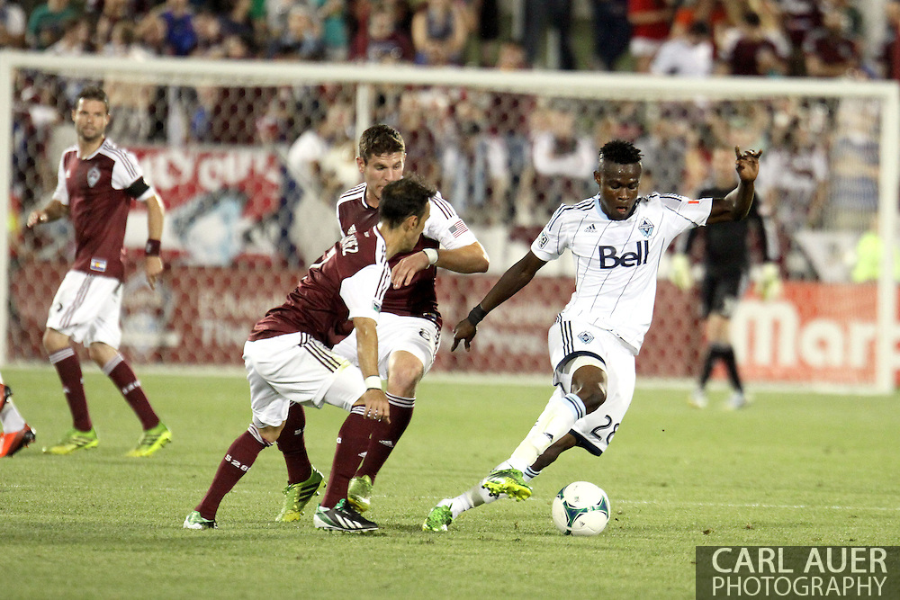 August 17th, 2013 - Vancouver Whitecaps FC midfielder Gershon Koffie (28) attempts to keep the ball away from Colorado Rapids forward Vicente Sánchez (7) and midfielder Dillon Powers (8) in the second half of action in the Major League Soccer match between the Vancouver Whitecaps FC and the Colorado Rapids at Dick's Sporting Goods Park in Commerce City, CO