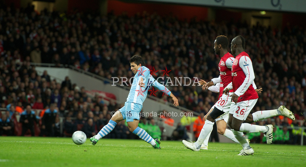 LONDON, ENGLAND - Tuesday, November 29, 2011: Manchester City's Sergio Aguero scores the opening goal during the Football League Cup Quarter-Final match at the Emirates Stadium. (Pic by Chris Brunskill/Propaganda)