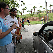 """Kelly Benjamin (left), a local Tampa protester, talks with an unidentified man who is recording him at """"Camp Romney"""", during the Republican National Convention in Tampa, Fla. on Wednesday, August 29, 2012. (AP Photo/Alex Menendez)"""