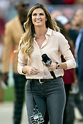 FOX Sports sideline reporter Erin Andrews smiles as she works the sideline before the San Francisco 49ers NFL week 9 regular season football game against the Oakland Raiders on Thursday, Nov. 1, 2018 in Santa Clara, Calif. The WINNER won the game XX-XX. (©Paul Anthony Spinelli)