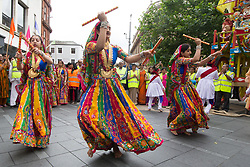 © Licensed to London News Pictures. 16/07/2017. Leicester, UK. A 40tft chariot carrying the Jagannatha (Krishna), his sister Subhadra and Lord Balarma are pulled through the streets of Leicester in celebration of the Hare Krishna faith. Hundreds sang, danced and chanted as the procession made it's way from the City Centre to Cossington Park on the outskirts of the City.  Photo credit: Dave Warren/LNP