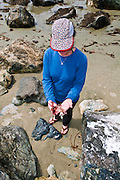 Woman beachcombing on Sand Dollar Beach, Los Padres National Forest, Big Sur, California