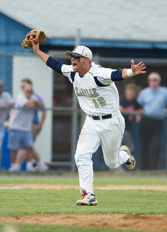 Third baseman Mike Piscapo celebrates after catching the final out to seal the win for LaSalle who defeated Hatboro-Horsham 7-5 in PIAA Class AAAA State Baseball semifinals at Spring-Ford. ( ED HILLE / Staff Photographer )