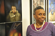 "Marion Sheppard, vision impaired photographer, next to Box Portrait of herself, at Artist Reception for Seeing with Photography Collective SWPC, a group of visually impaired, sighted and totally blind photographers based in NYC, on Saturday, April 28, 2012, at African American Museum, Hempstead, New York, USA, and hosted by Long Island Center of Photography. Aperture published the group's ""Shooting Blind: Photographs by the Visually Impaired"" in 2005."