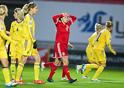 LLANELLI, WALES - Wednesday, April 9, 2014: Wales' Natasha Harding looks dejected against Ukraine during the FIFA Women's World Cup Canada 2015 Qualifying Group 6 match at Parc-y-Scarlets. (Pic by David Rawcliffe/Propaganda)