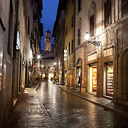 Via Dei Neri with the tower at Palazzo Vecchio in Florence, Italy.