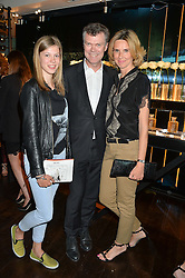 Left to right, VENDELA DENIS, her father PIERRE DENIS he is CEO of Jimmy Choo Ltd  and PIA DENIS at the launch of Illicit by Jimmy Choo - a new fragrance faced by Sky Ferreira, held at Mondrian London, 20 Upper Ground, London on 3rd June 2015.