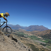 Dario Takada from Christchurch in action during the NZBNZ South Island Downhill Cup mountain bike downhill series held on The Remarkables face with a stunning backdrop of the Wakatipu Basin. 150 riders took part in the two day event.  Queenstown, Otago, New Zealand. 9th January 2012. Photo Tim Clayton