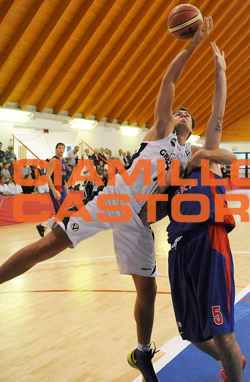 DESCRIZIONE : Lizzano in Belvedere Lega A 2013-14 Granarolo Virtus Bologna PBC CSKA Moskow <br /> GIOCATORE : Aleksandar Petrovic<br /> SQUADRA : Granarolo Virtus Bologna  <br /> EVENTO : PRECampionato Lega A 2013-2014<br /> GARA :  Granarolo Virtus Bologna PBC CSKA Moskow<br /> DATA : 17/09/2013<br /> CATEGORIA : Rimbalzo<br /> SPORT : Pallacanestro<br /> AUTORE : Agenzia Ciamillo-Castoria/A.Giberti<br /> Galleria : Lega Basket A 2013-2014<br /> Fotonotizia : Lizzano in Belvedere Lega A 2013-14 Granarolo Virtus Bologna PBC CSKA Moskow  <br /> Predefinita :