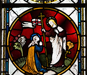 Stained glass window roundel depicting Jesus Christ and Mary Magdelene 'Noli me Tangere'  James Powell and Sone, 1905 in church of Saint Mary, Potterne, Wiltshire, England