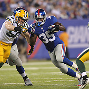 Andre Brown, (right), New York Giants, is tackled by A.J.Hawk, Green Bay Packers,  during the New York Giants Vs Green Bay Packers, NFL American Football match at MetLife Stadium, East Rutherford, New Jersey, USA. 17th November 2013. Photo Tim Clayton