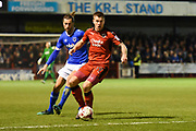 Crawley Town forward James Collins (19) on the ball under pressure from Portsmouth defender Christian Burgess (6) during the EFL Sky Bet League 2 match between Crawley Town and Portsmouth at the Checkatrade.com Stadium, Crawley, England on 7 March 2017. Photo by David Charbit.