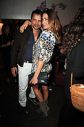 LISA SNOWDON and GERRY DEVEAUX at the 3rd anniversary party of the Maddox Club, Mill Street, London on 28th April 2010.