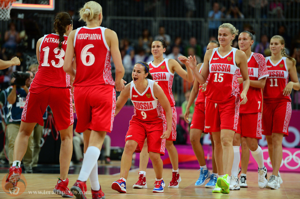 Jul 28, 2012; London, United Kingdom; Russia guard Becky Hammon (9) celebrates with her team after the game against Canada at Basketball Arena. Russia defeated Canada 58-53.