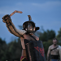 Aquileia, Italy - 17 June 2018: A Gladiator shows his armour and weapon before fighting during Tempora in Aquileia, ancient Roman historical re-enactment
