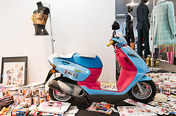 © Licensed to London News Pictures. 26/07/2018. London, UK.  An Italian Aprilla scooter that was a sponsorship deal with the Spice Girls is on display at the Spice Girls exhibition. The interactive exhibition features hundreds of iconic stage, music video and film costumes worn by the popular 90s girl band at Business Design Centre/Photo credit: Ray Tang/LNP
