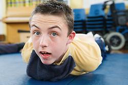 Boy with brain injury exercising,