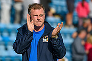 Coventry City manager Mark Robins applauds the fans after the EFL Sky Bet League 1 match between Gillingham and Coventry City at the MEMS Priestfield Stadium, Gillingham, England on 25 August 2018.