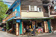 27 APRIL 2013 - BANGKOK, THAILAND:   Traditional shophouse architecture in Talat Noi. The Talat Noi neighborhood in Bangkok started as a blacksmith's quarter. As cars and buses replaced horse and buggy, the blacksmiths became mechanics and now the area is lined with car mechanics' shops. It is one the last neighborhoods in Bangkok that still has some original shophouses and pre World War II architecture. It is also home to a  Teo Chew Chinese emigrant community.         PHOTO BY JACK KURTZ