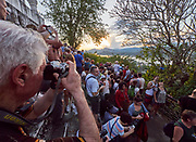 Laos. Luang Prabang. Mount Phousi. Tourist hordes enjoying the sunset view over Luang Prabang and the Mekong from Wat Chom Si.
