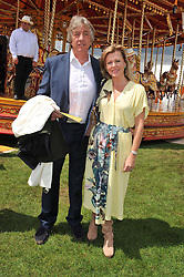 NICK & EIMEAR COOK at the 2012 Veuve Clicquot Gold Cup Final at Cowdray Park, Midhurst, West Sussex on 15th July 2012.