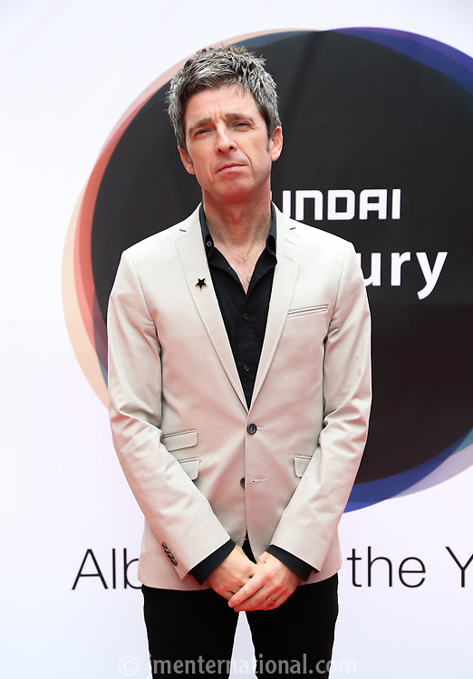 Noel Gallagher at arrival boards