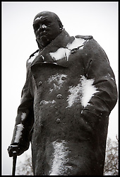 A Statue of Winston Churchill in Parliament Square covered in Snow in  London,  Friday January 18, 2013. Photo By Andrew Parsons / i-Images