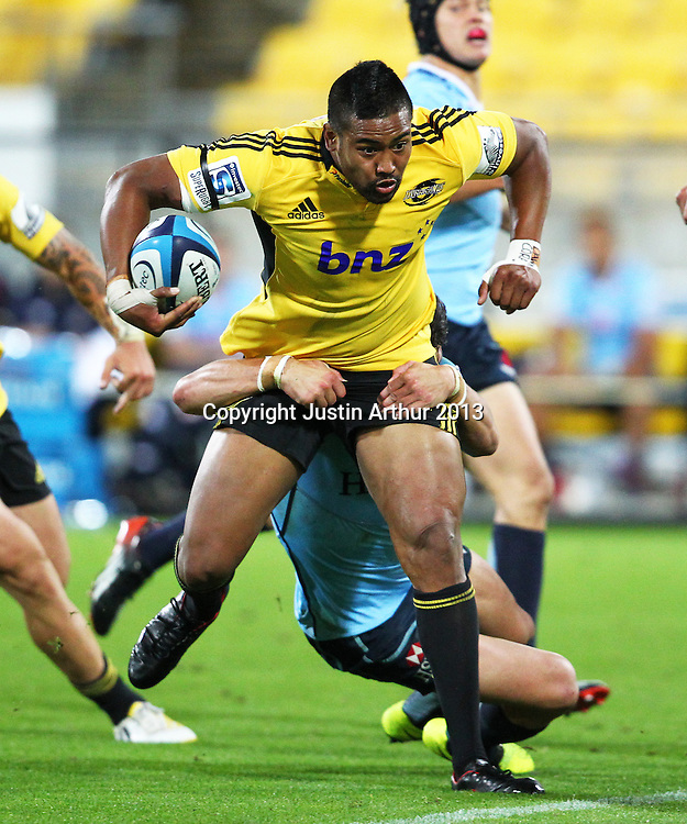 Hurricans' Julian Savea on the attack during the 2013 Super Rugby season - Hurricanes v Waratahs, Westpac Stadium, Wellington, New Zealand on Saturday 6 April 2013. Photo: Justin Arthur / photosport.co.nz