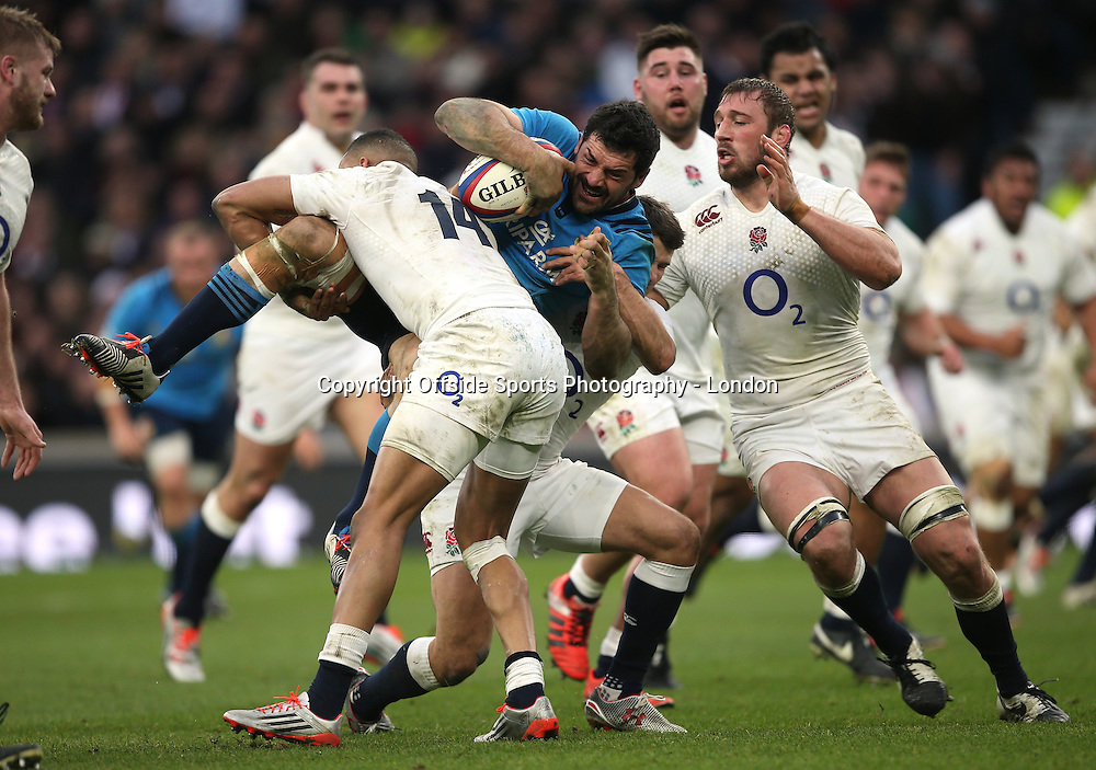 14 February 2015 - 6 Nations Rugby - England v Italy ;  England captain Chris Robshaw arrives as Andrea Masi of Italy is tackled.<br /> Photo: Mark Leech
