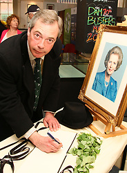 Nigel Farage signs Margaret Thatcher book of Condolence, 2013. Photo by Paul Marriott / i-Images. .UK Independence Party (UKIP) leader Nigel Farage, after signing the book of condolence for Margaret Thatcher in Grantham, Lincolnshire..Former UK Prime Minister Baroness Margaret (Maggie) Thatcher was born in Grantham, Lincolnshire, in 1925, and led the Conservative Party to three consecutive victories.<br /> <br /> File photo - One year ago: Baroness Thatcher died.<br /> On Tue, Apr 8 2014 it will be one year since the Longest-serving UK Prime Minister of the 20th century, the first and only woman to serve in the role to date, died on April 8, 2013  after suffering a stroke.