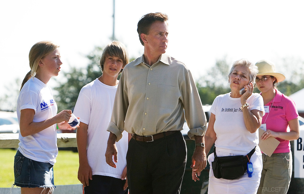 GOSHEN, CT - AUGUST 5:  Greenwich, CT businessman Ned Lamont walks away after talking to Vita Muir, Executive Director of the Litchfiled Jazz Festival,right white shirt, before he attempted to campaign at the event in Goshen, CT. Lamonts children Teddy,13, and Lindsay,15, look on,left. Lamont and his supporters including actor Danny Glover and California Congreeswoman Maxine Waters were first told they would not be allowed to enter the festival by organizer Vita Muir. Muir later said they could enter and enjoy the jazz, but not campaign. Lamont is in a heated race for the Connecticut democratic nomination for Senate against Sen. Joe Lieberman. (Photo by Bob Falcetti/Getty Images)