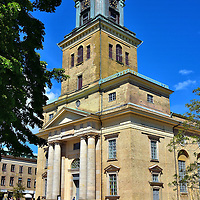 Exterior of G&ouml;teborgs Domkyrka in Gothenburg, Sweden <br /> G&ouml;teborgs Domkyrka is the city&rsquo;s third cathedral since 1624. After the two previous ones were destroyed by fire, construction on this church began at the start of the 19th century and it was consecrated in 1815. The clock tower was built ten years later and, in 1827, the copper top was added as the crown to its 173 foot height.  It is reported that approximately 20,000 people are buried around Gothenburg Cathedral with another 3,000 inside.