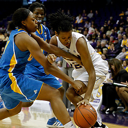 December 13, 2011; Baton Rouge, LA; UCLA Bruins forward Atonye Nyingifa (11) battles for possession with LSU Lady Tigers forward Krystal Forthan (12)during the second half of a game at the Pete Maravich Assembly Center. LSU defeated UCLA 58-41. Mandatory Credit: Derick E. Hingle-US PRESSWIRE
