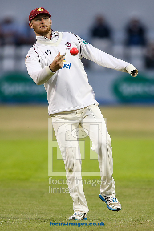 Rob Keogh of Northamptonshire CCC throws the pink ball during the Specsavers County C'ship Div Two match at the County Ground, Northampton<br /> Picture by Andy Kearns/Focus Images Ltd 0781 864 4264<br /> 26/06/2017